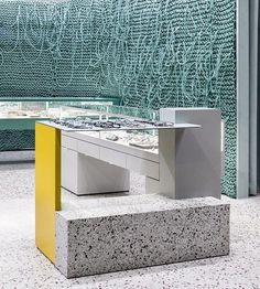 grey walls and terrazzo flooring provide a blank canvas for the splashes of color inside ENDPIECE glasses store by wallga + WGNB. Retail Store Design, Retail Shop, Window Display Retail, Retail Displays, Shop Displays, Store Concept, Interior Architecture, Interior Design, Interior Concept