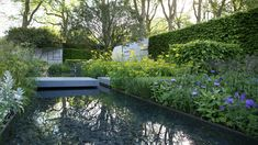 Floating stone bridge above reflections in a 22m water rill - The Telegraph Garden by Marcus Barnett - Chelsea Flower Show 2015