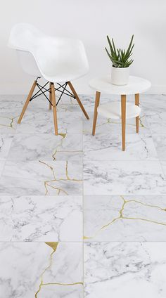 Chaji is a fascinating Marble Kintsugi Tile Effect Flooring design created by Atrafloor. This unique flooring is inspired Kintsugi – the ancient Japanese art of fixing broken materials like marble by filling in the cracks with gold. In doing so, the design becomes even more beautiful than before. #vinyl #flooring #inspiration #design #decor #home #homedecor #interior #interiordesign #Ihavethisthingwithfloors