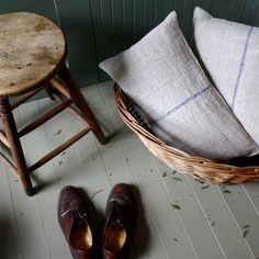grain sack, white floor, wood and wicker