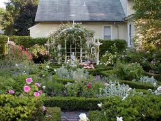 Check out the before-and-afters to see the transformation of a hardscrabble backyard to this lovely formal English rose garden. | thisoldhouse.com