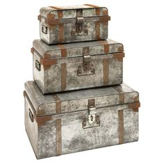 Add a rustic touch to your living room with this 3-piece trunk set. Crafted of galvanized metal with rivets and contrasting tan banding, it is the perfect pl...