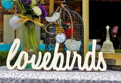 wedding event planner. design and decoration. summer. fresh. spring. flowers. twigs. rustic. vintage. lovebirds sign
