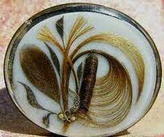Broche realizado con cabello humano