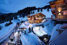 Aussenansicht im Winter der Sporer Alm Luxus Chalet mit Whirlpool