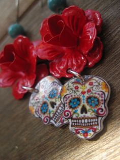 $23.00 Sugar Skull, Day of the Dead, Dia de los Muertos, Antique red enamel rose Calavera Earrings, Vintage Tattoo Flash design, Mexican Jewelry. $23.00, via Etsy.