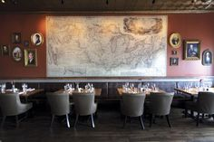 Three Flags Tavern, St. Louis. Restaurant design, vintage map, gray leather chairs, oil painting portraits, bar, rustic
