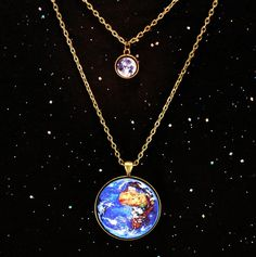 Keep your home close to your heart, along with your little friend who tags along...aka the Earth and moon! Its out of this world!