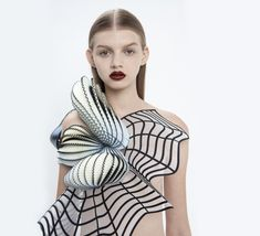the real and the virtual blend into one another in a digitally-aware collection from Israeli fashion designer Noa Raviv.