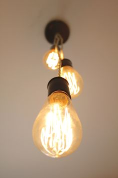 A beautiful triple #Edison #bulb #light #fixture for your #home or #office, showing off the bulb #filament! It's a #vintage yet #modern #accent for your #kitchen, #diningroom, #foyer, #livingroom, #den, or #workspace and is unique to any other fixture you may find! Can be customized in a cascading #staggered format, #customize yours!  Crafted by @7M Woodworking and can be found on www.etsy.com/... #interior #home #chandelier #lighting #simple #reuse #decor #hanging #Chicago