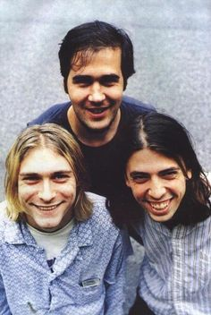 This is Nirvana. Dave Grohl is on the right. He was the drummer. I bet you didn't know he's the front man for the Foo Fighters.
