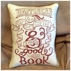 Happiness is a cup of coffee and a good book. The perfect reading nook pillow.