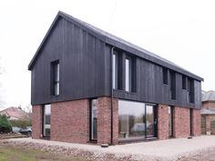 Half brick, half wood, simple and stuffed. Brick Cladding, House Cladding, Exterior Cladding, Facade House, Modern Brick House, Timber House, Modern Houses, Architectural Technologist, Building A House