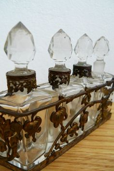Art nouveau perfume bottles in metal casing by desmadeleines, $125.00