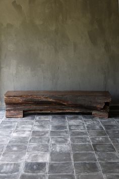 Rustic wood bench & lime wall