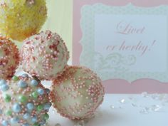 pastel colors on cake pops.  Modern, chic dessert to have in a Candy Bar