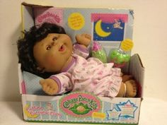 Cabbage Patch Kids Bedtime Bunnybee Baby - Brown Skin, Curly Black Hair, Brown Eyes by Jakks. $38.95. baby powder smell. Realistic eyes that open and  close. Adorable accessories that fit into babies mouth and hands. This Cabbage Patch kid comes with adoption papers and name.  This doll is adorable with a pink and purple nighty, dark skin, hair, and brown eyes