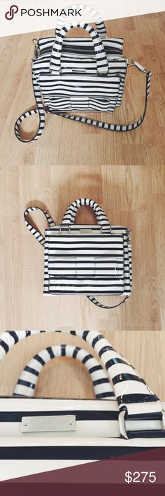 KATE SPADE ♠️ STRIPED PATENT HANDBAG WITH BOW EXCELLENT CONDITION, USED ONCE. Kate Spade Patent Bag with Bow. Ecru with black stripes and gold hardware, matching lining accented with polka dots. Structured handbag with four pockets; one external, three inside and one with full-zip. This bag has been kept in storage inside a dust bag, I am still absolutely in love with it ❤️ but would prefer for it to go to a home where it will see frequent use. Purchased directly from Kate Spade Retail…