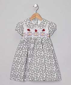Reminiscent of days gone by, this frock keeps the tradition of smocking alive by stylishly outfitting darlings for creating memories today. Back buttons ensure easy-peasy changing, while the tie creates a perfect fit for this lined number.