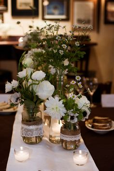 Rehearsal Dinner Flowers: We DIY'ed the mason jars with various kinds of burlap and lace