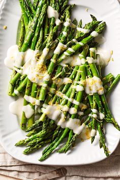 Toum, a creamy Middle Eastern sauce, is a fresh topper for in-season spring asparagus. Our take blends garlic, lemon, oil, and a touch of honey. #easterdinner #easterfood #easterrecipes #eastersidedishrecipes #easterideas #bhg
