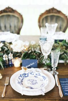 Blue place setting with vintage reception chairs   Stephanie Yonce Photography and Amore Events by Cody   see more on: http://burnettsboards.com/2014/08/european-flavored-al-fresco-rehearsal-dinner/