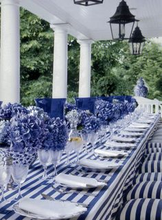 blue and white stripes, on the porch, with blue hydrangeas and blue hurricanes w/votive candles.