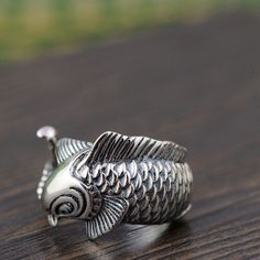Silver Koi Carp Ring, handcrafted from sterling silver and available at https://takumiarts.com Fine Japanese Jewelry from myths and legends : Dragon, Phoenix, Maneki Neko, Koi Carp, Sakura flowers, Youkai and much more. Handcrafted from sterling silver, pure silver and 18k gold. Free shipping and worry-free returns.