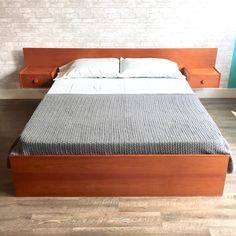 What do you think of this? Mid-Century Teak .... You can check it out here: http://vintagehomeboutique.ca/products/mid-century-teak-queen-size-bed-frame-with-floating-side-tables?utm_campaign=social_autopilot&utm_source=pin&utm_medium=pin