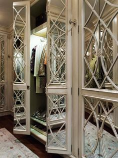Beaux Arts Mansion - Chic closet with mirrored doors and shoe shelves.