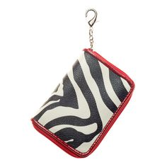 Zip Purselet-Zebra Grace Adele Clip-on    Tuck away your day-to-day essentials or keep them clipped and close.     • Interior pockets  • Zip closure  • Lobster clasp    https://myfashions.graceadele.us/GraceAdele/Buy/ProductDetails/10440