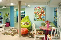 basement play room for older kids, note designated areas for various play