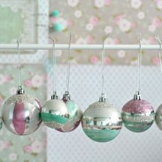Hand painted cheap plastic baubles are given a makeover with nail polish and glitter.