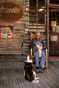 a man relaxes in rocking chair on the back porch of the Mast General Store in Valle Crusis, NC while his pooch waits eagerly for his share of the goods. Old General Stores, Old Country Stores, Country Life, Going Up The Country, Rocking Chair Porch, Rustic Wall Art, Peaceful Life, Old Florida, Fine Art America