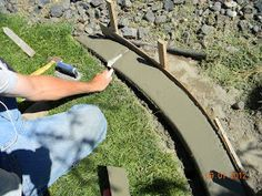 DIY Concrete Landscape Edging Tutorial - So cheap easy. Maybe try around fence edge to keep the dogs from digging out?