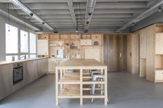 Office: Wooden Cabinetry And Decor Give The Office Kitchen A Cozy Look - OutOfOffice Frankfurt: Modern Industrial Space for Meetings and Workshops Arch Interior, Studio Interior, Interior Architecture, Interior Design, Contemporary Architecture, Frankfurt, Casa Patio, Cocinas Kitchen, Charleston Homes