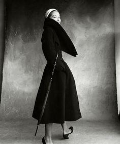 Irving Pen, Lisa Fonssagrives, wearing a coat by Christian Dior, Vogue October, 1950