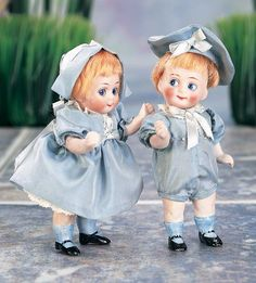 """Pair,German All-Bisque Googlies with Painted Blue Socks 4.5"""" (11 cm.) Each has bisque swivel head on kid- edged bisque torso,blue glass googly side- glancing eyes"""