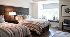 POWELL & BONNELL  Love the custom wood panels/nightstand