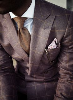 """""""A well tailored suit is to a woman what lingerie is to a man"""""""