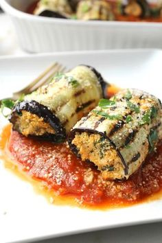 A light, easy and fresh dinner - Mediterranean Vegan Eggplant Roll Ups. A combination of seasoned cauliflower rice rolled up in grilled eggplant over marinara | ThisSavoryVegan.com #vegan #plantbased