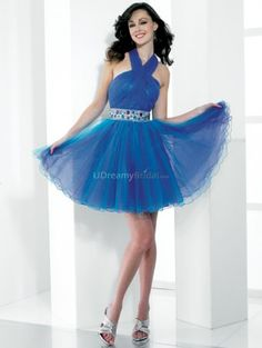 Blue A-line homecoming dress with halter neckline and backless design. Organza overlaying satin skirt features beaded waist band. Free made-to-measurement service for any size. Available colors seen as in Color Options.