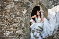 bride playing with the dress at an old fortress