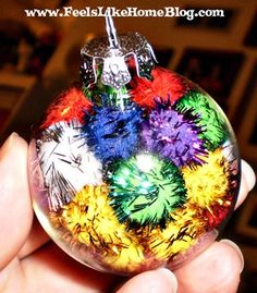 easy ornament for kids to make with plastic balls and tinsel pom poms . Christmas