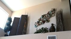 Dear Gail: Our home has great vaulted ceilings, but with them we also have a very high pot shelf ledge about 10 feet up in our living room. It is 8 feet high and 11 feet long with a 16 inch deep ledge. We are stumped on what to place up there. Can you help? — Jordon
