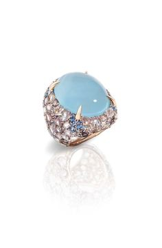 Pomellato Pom Pom collection ring featuring a light-blue cabochon surrounded by aquamarines and a pavé of brown diamonds. Aquamarine Jewelry, Gemstone Jewelry, Dior Ring, Pomellato, High Jewelry, Jewellery, Italian Jewelry, Blue Gemstones, Ring Designs