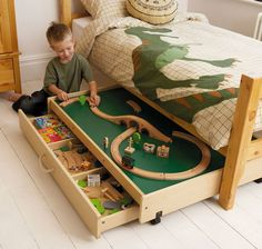 Underbed play table: A brilliant play area as well as useful toy storage for bedrooms that are short on space. The table will fit under most beds and rolls out easily. The storage drawer is on castors so your kids can just wheel it out for easy access. Features: reversible top with blackboard on one side and white on the other, and jute rope handle. @ http://www.gltc.co.uk/