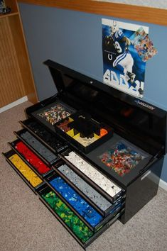This tool box storage with stacked drawers keep LEGO collection sorted by color. It's perfect in form and function. http://hative.com/creative-lego-storage-ideas/