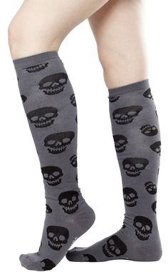 """SOURPUSS 19"""" LUST FOR SKULLS SOCKS CHARCOAL Our Lust for Skulls pattern is now available on our soft 19"""" knee socks! 70% Cotton, 20% Nylon, 10% Spandex. 17"""" inches high."""