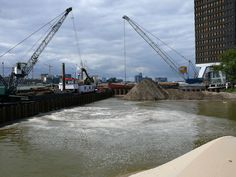 https://flic.kr/p/iaNebb   2007.08 - 'View over the last construction area', of the metro-tunnel, along the border of river IJ, opposite Central Station  Amsterdam; Dutch urban city photo + geotag, Fons Heijnsbroek, The Netherlands   Photo of building cranes are transporting sand and mud; a view over the construction site with sheet piling,  for the last part of the metro-tunnel, along the border of river IJ, opposite Central Station Amsterdam.  Urban photography of civil engineering…